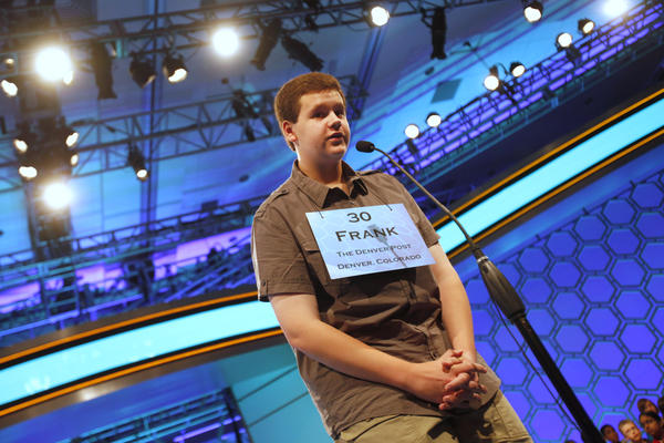 Frank Cahill, 14, of Parker, Colo., spells a word correctly during the third round of the National Spelling Bee in 2012. This week the Bee announced that competitors will have to know the definitions of words in addition to the spelling.