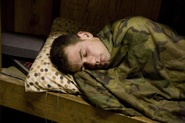 "Forward observer Murphy sleeping, Korengal, July 2008. ""I thought nothing was going on because there was no combat,"" Junger recalls. ""And Tim saw potential in everything, including a situation where nothing's happening."""