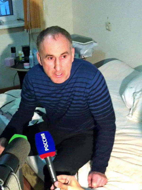 In this image taken from a cellphone video, the father of the Boston bombing suspects, Anzor Tsarnaev, talks to the media about his sons, in his home in Makhachkala, the Dagestani capital, on Friday.