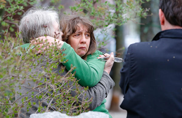 A woman is questioned by the Cambridge Police and other law enforcement agencies during a door-to-door search in Watertown for 19-year-old Boston Marathon bombing suspect Dzhokhar Tsarnaev.