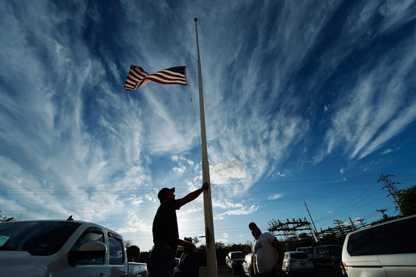 In Texas, veteran Bill Warren lowers a flag to half-staff in memory of victims from the West Fertilizer Co. explosion last week. The nation has absorbed the past six days of nonstop tragedy and relief in a firsthand-once-removed way that now defines our communal experiences.