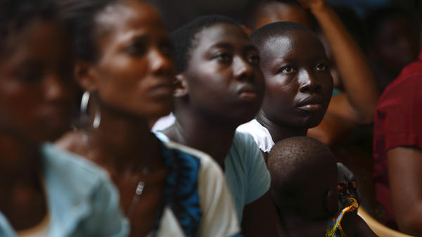 Young women listen to a talk on domestic violence and HIV prevention near Lome, Togo, in April. Abused women in sub-Saharan Africa and India are at higher risk for HIV than women who haven't experienced violence.