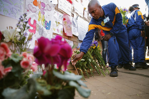 South African Police Academy trainees leave flowers for Mandela outside the Medi-Clinic Heart Hospital in Pretoria on June 25. Mandela had been admitted to the hospital for a recurring lung infection.