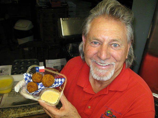 Butch Benavides — a Mexican food restaurateur turned fry-master — shows off his Texas fried fireball.