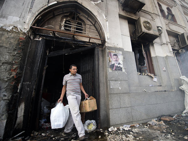 A physician collects medical equipment and medicines from the remains of the partially destroyed Rabaa al-Adawiya mosque compound hospital in Cairo on Aug. 15.