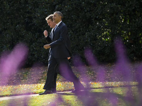 President Obama walks with the chairman of the Democratic Senatorial Campaign Committee, Colorado Sen. Michael Bennet, on the South Lawn of the White House on Wednesday.