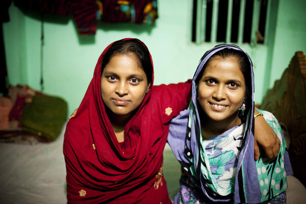 Minu (left) and her younger sister Shumi worked on the Planet Money men's T-shirt.