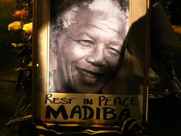 People in Johannesburg pay tribute to Nelson Mandela, the revered icon of South Africa's anti-apartheid struggle.