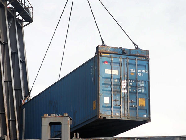 The container carrying the Planet Money women's T-shirts is loaded onto a ship in Cartagena, Colombia.