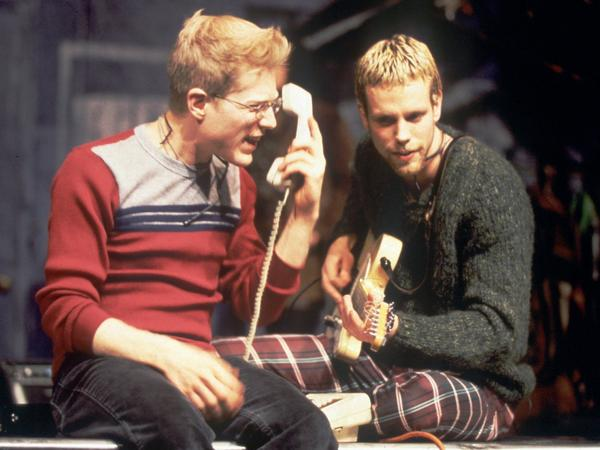 Anthony Rapp (left) and Adam Pascal perform a scene from the New York Theatre Workshop production of <em>Rent</em> in 1996.