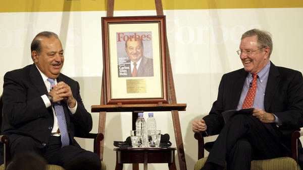 Carlos Slim Helu (left) talks with Steve Forbes of <em>Forbes</em> magazine. The magazine lists the Mexican telecom mogul as the world's richest man, with a net worth of $73 billion.