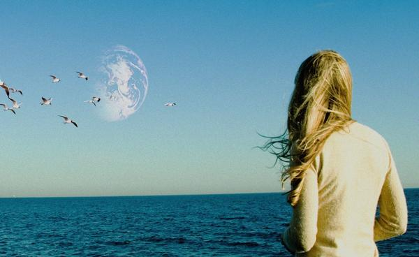 The 2011 film <em>Another Earth</em>, directed by Mike Cahill, explores very human questions against an improbable backdrop.