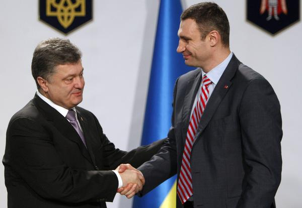 Boxer-turned-opposition leader Vitali Klitschko, right, dropped out of Ukraine's presidential election set for May 25. He says he will help business tycoon and politician Petro Poroshenko, left, who made a fortune selling chocolates. He favors closer ties with the West.