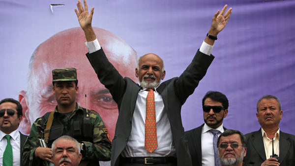 Presidential candidate Ashraf Ghani waves to supporters during a campaign rally in Kabul on Tuesday. He is one of the three leading candidates in Saturday's presidential election.