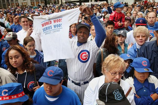 "One of the Cubs' most famous fans, Ronnie ""Woo-Woo"" Wickers (center), celebrates the team making it into the playoffs in 2007. The Cubs hadn't been in the World Series since 1945 and haven't won it since 1908."