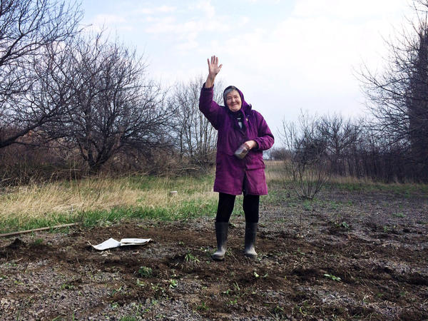 "In the rundown Ukrainian town of Perewalsk, near the Russian border, 80-year-old Lida Vasilivna has just planted a garden. ""Business just went belly up,"" she says about her town's hard times, after asking, ""Are you gonna put this granny on TV?"""
