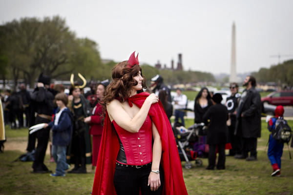 An attendee dressed as the Scarlet Witch waits to be counted by the Guinness World Record officials.