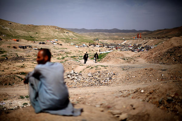 <p>A man sits near the entrance to Kamar Kulagh, just outside Herat and near the border with Iran. The wars and upheavals in Afghanistan over the past three decades have contributed to the widespread use of drugs.</p><p></p>