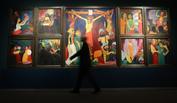 "A man walks past Emile Nolde's ""Das Leben Christi"" (1911/12, Life of Christ) at the Städel Museum."