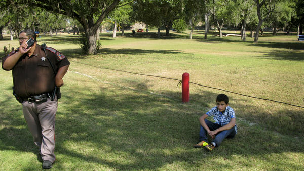 Jorge Romero, 16, a Salvadoran migrant, waits for the Border Patrol in McAllen, Texas.