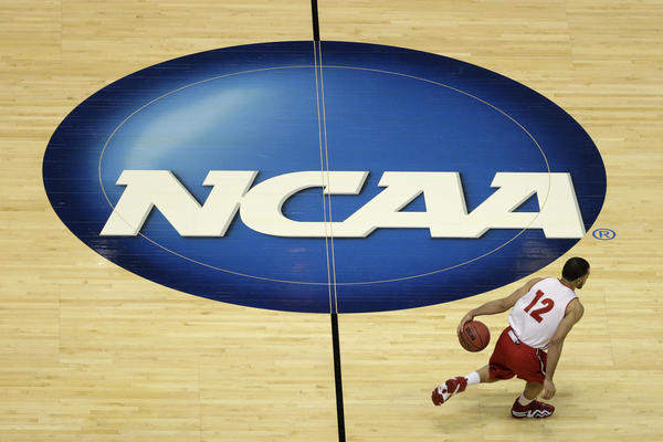 """Wisconsin's Traevon Jackson at practice for the 2014 NCAA men's college basketball tournament. Commentator Frank Deford says that, despite NCAA claims to the contrary, most college players are not typical students — """"their job is to play a sport."""""""