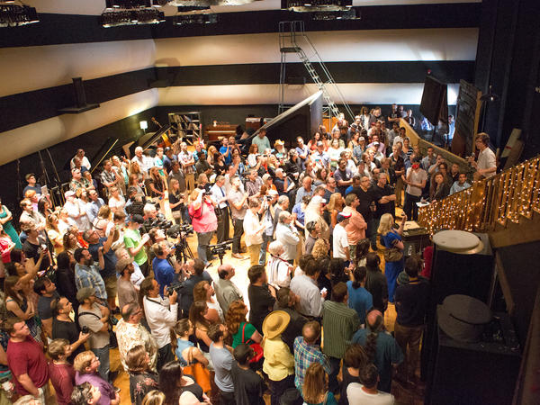 Inside RCA Studio A, whose sale has sparked a wave of backlash from the Nashville music community, Ben Folds (right, on staircase) addresses press and supporters.