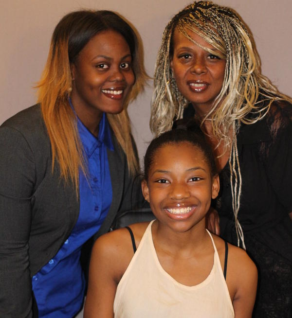 Kai Leigh Harriott (center) with her sister Aja David (left) and their mother, Tonya David. Aja just graduated from college and Kai is headed to high school. The man who shot Kai is serving a 13- to 15-year sentence.