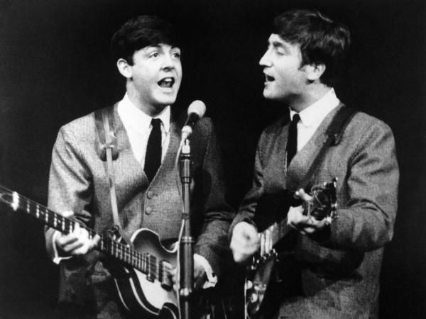Paul McCartney and John Lennon during a concert in London on Nov. 11, 1963.