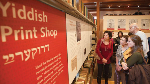 Visitors look at an exhibit at the National Yiddish Book Center in Amherst, Mass.