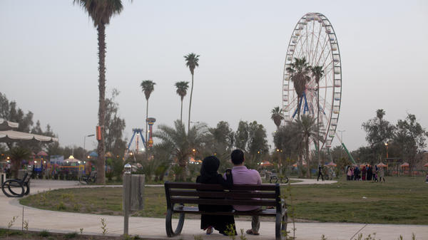 Militants have carried out massacres and suicide bombings in the north, but have not taken hold in Baghdad, though violent deaths swelled in the city this summer. In al Zawra park, visitors escape the tension to enjoy lawns, fountains and a giant Ferris wheel.