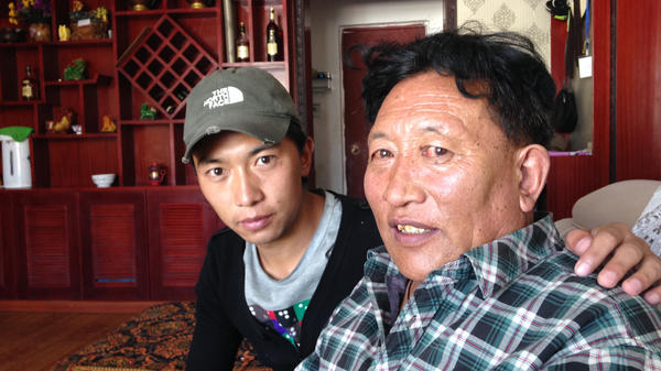 Zhaxi Cairang (right), a 59-year-old Tibetan nomad, moved to a city in western China 15 years ago as part of a government effort to settle nomads. But Zhaxi says he plans to return to herding yaks next year. His son Cicheng Randing was raised in the city, but his father wants to expose him to traditional nomadic life as well.