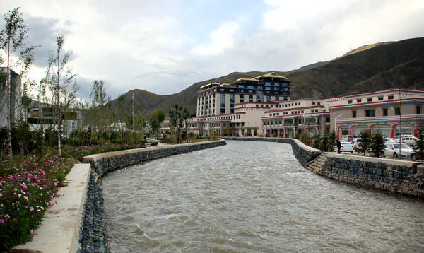 The Zhaqu River flows past newly built buildings in Yushu prefecture. The Zhaqu feeds into the Lancang River, which flows into the Mekong.