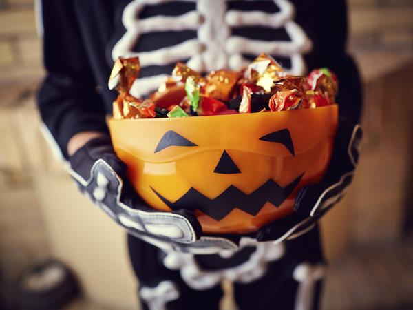 The scariest part of the holiday comes in the days that follow, as parents fight and negotiate to limit how much candy their kids eat. NPR's Gisele Grayson decided to pay her kids off to give up their loot.