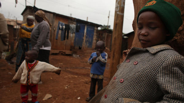 The children of Millicent Atieno play in front of their home in August 2009 in the Kibera slum in Nairobi, Kenya. Millicent was one of dozens of Kibera residents to start a local business with the assistance of cash grants provided by a nongovernmental organization. Hairdressers, grocery stores and food vendors were just some of the businesses financed through the program.