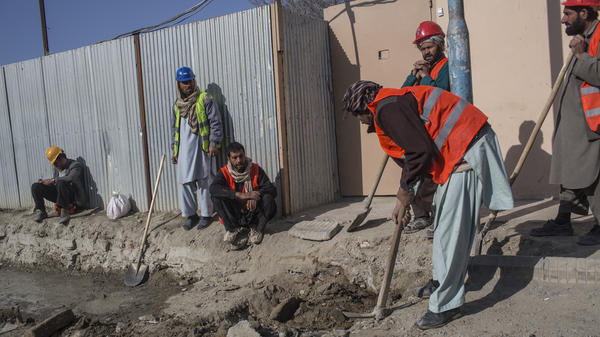 Afghan laborers work on a road project in Kabul. The city has undertaken a huge project to fix its roads and sewers.