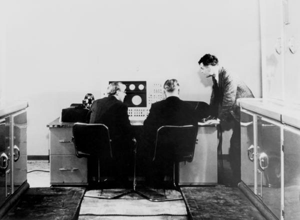Alan M Turing and colleagues work on the Ferranti Mark I Computer in the United Kingdom in 1951.
