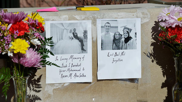 Flowers sit outside the University of North Carolina School of Dentistry in recognition of dentistry student Deah Barakat, 23, his wife, Yusor Abu-Salha, 21, and her sister, Razan Abu-Salha, 19, on Wednesday in Chapel Hill. Deah and Yusor grew up together, and both attended Al-Iman School, an Islamic elementary and middle school in nearby Raleigh.