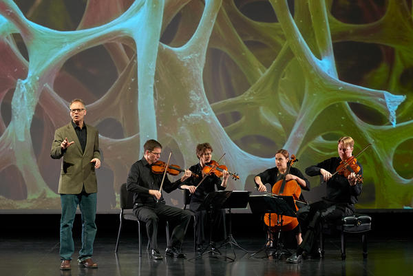 "Robert Davies (standing) and the quartet during a performance of ""The Crossroads Project."" Musicians include (left to right) Robert Waters, Rebecca McFaul, Anne Francis Bayless and Bradley Ottesen."
