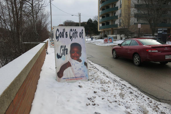 A poster put up by an abortion opponent outside Preterm clinic in Cleveland. Preterm is seeing more women, and from farther away, since new restrictions shuttered a number of the state's other clinics that perform abortion.