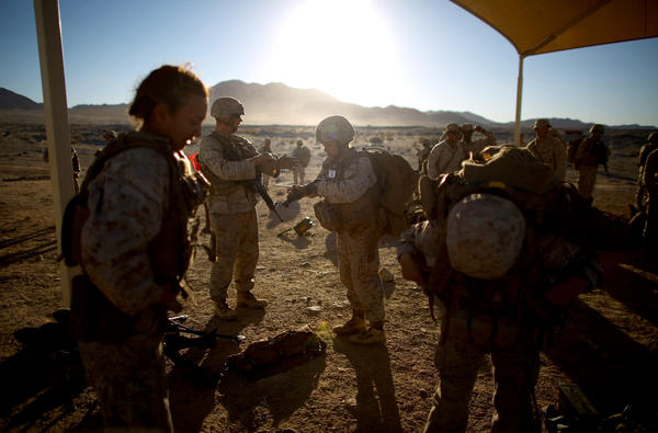 Female and male Marines prepare for a live-fire exercise at Twentynine Palms, a training camp in the Mojave Desert.