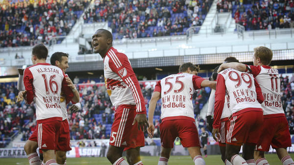 New York Red Bulls defender Chris Duvall (third from left) reacts toward the crowd after teammate Lloyd Sam scores during an MLS soccer game against D.C. United on March 22 in Harrison, N.J. The Red Bulls won 2-0.