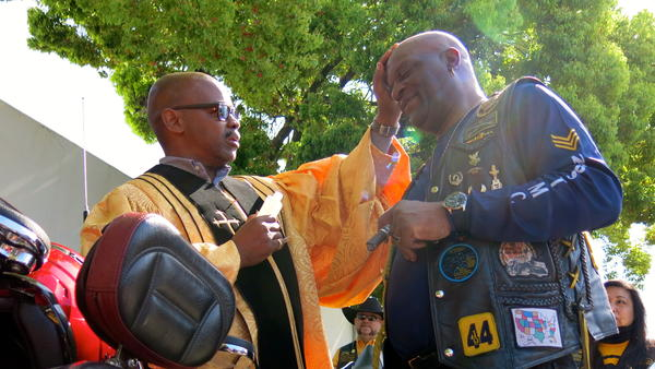 Reverend Jeff Moore blesses a biker at the Buffalo Soldiers Motorcycle Club rally in San Jose, Calif.