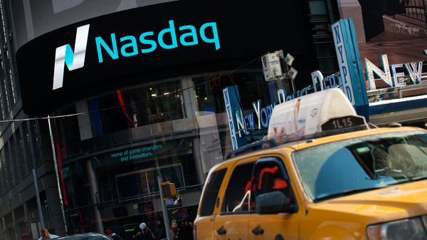 As the Nasdaq closes above the record set 15 years ago, stock analysts are debating whether the market is approaching another bubble.