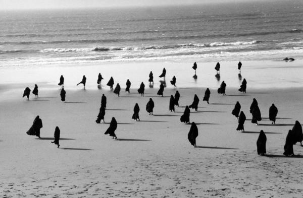 Shirin Neshat is an Iranian-born visual artist who has made her home country's turbulent history the subject of high art. The Hirshhorn Museum in Washington, D.C., is hosting a retrospective of her work. Above, Neshat's 1999<em> Rapture Series.</em>