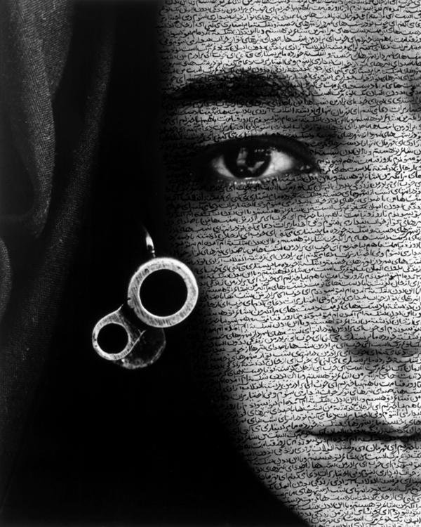 Calligraphy is often layered on the people in Neshat's photos. It falls over them like veils, or tattoos their skin. Curator Melissa Ho says text gives these silent faces a voice. Above, Neshat's 1996 work <em>Speechless</em> from the <em>Women of Allah </em>series.