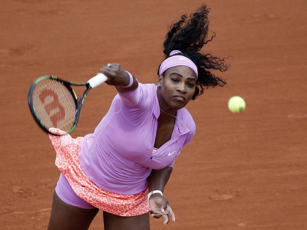 Serena Williams serves the ball to Andrea Hlavackova during the first round of the French Open in Paris.