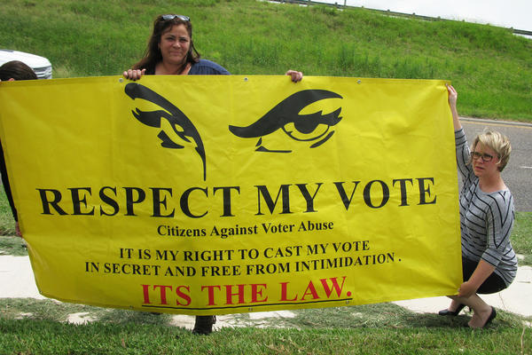 Mary Helen Flores (center) is the founder of Citizens Against Voter Abuse.