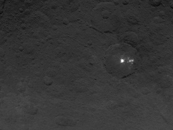 A cluster of mysterious bright spots on dwarf planet Ceres can be seen in this image, taken by NASA's Dawn spacecraft.