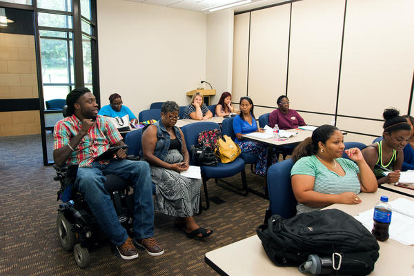 Nnaka has a discussion with fellow students during a class at Langston University's Tulsa campus.