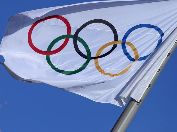 The Olympic flag flutters near the Cauldron at the Olympic Park during the 2014 Sochi Winter Olympics.